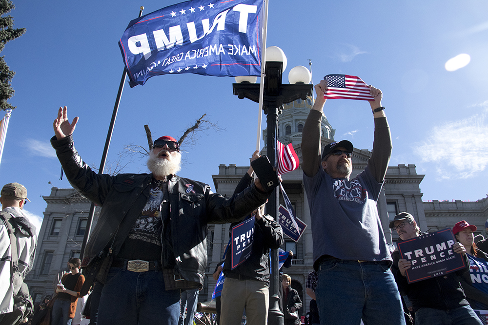 Pro-Trump supporters stand at the edge of their rally in oppososition of a group of anarchist protesters, Mar. 4, 2017. (Kevin J. Beaty/Denverite)  protest; rally; copolitics; kevinjbeaty; denver; colorado; denverite; capitol hill;