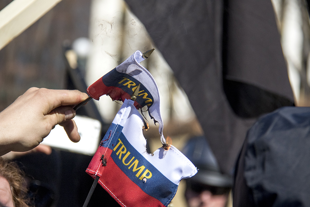Anarchist protesters burn Trump flags. A pro-Trump rally that was opposed by a group of anarchist protesters, Mar. 4, 2017. (Kevin J. Beaty/Denverite)  protest; rally; copolitics; kevinjbeaty; denver; colorado; denverite; capitol hill;