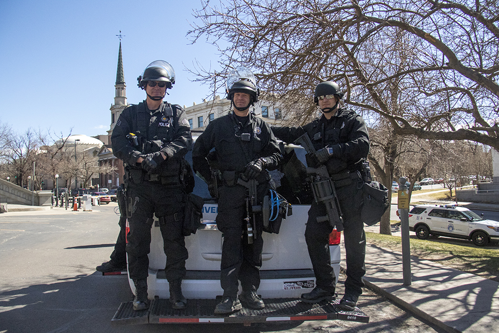 Police in riot gear stand at the side of the rally. A pro-Trump rally that was opposed by a group of anarchist protesters, Mar. 4, 2017. (Kevin J. Beaty/Denverite)  protest; rally; copolitics; kevinjbeaty; denver; colorado; denverite; capitol hill;