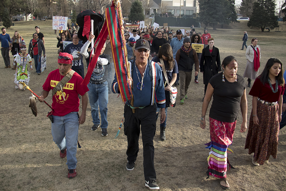 Robert Cross leads the march out of Sunken Gardens Park. A rally against the Dakota Access Pipeline, March 10, 2017. (Kevin J. Beaty/Denverite)  march; protest; rally; sunken gardens; capitol; indigenous; native american; nodapl; dakota access pipeline; standing rock; kevinjbeaty; denver; denverite; colorado;