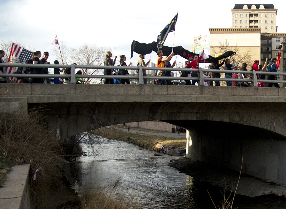 "Protesters shout, ""Water is Life."" A rally against the Dakota Access Pipeline, March 10, 2017. (Kevin J. Beaty/Denverite)  march; protest; rally; sunken gardens; capitol; indigenous; native american; nodapl; dakota access pipeline; standing rock; kevinjbeaty; denver; denverite; colorado;"