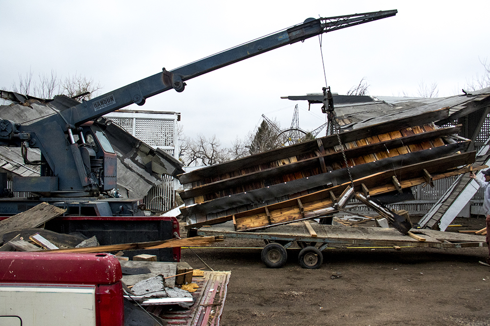 Workers clear wreckage at Lakeside Amusement Park after a car ran into its parking structure, March 11, 2017. (Kevin J. Beaty/Denverite)  lakeside amusement park; denver; colorado; kevinjbeaty; denverite;