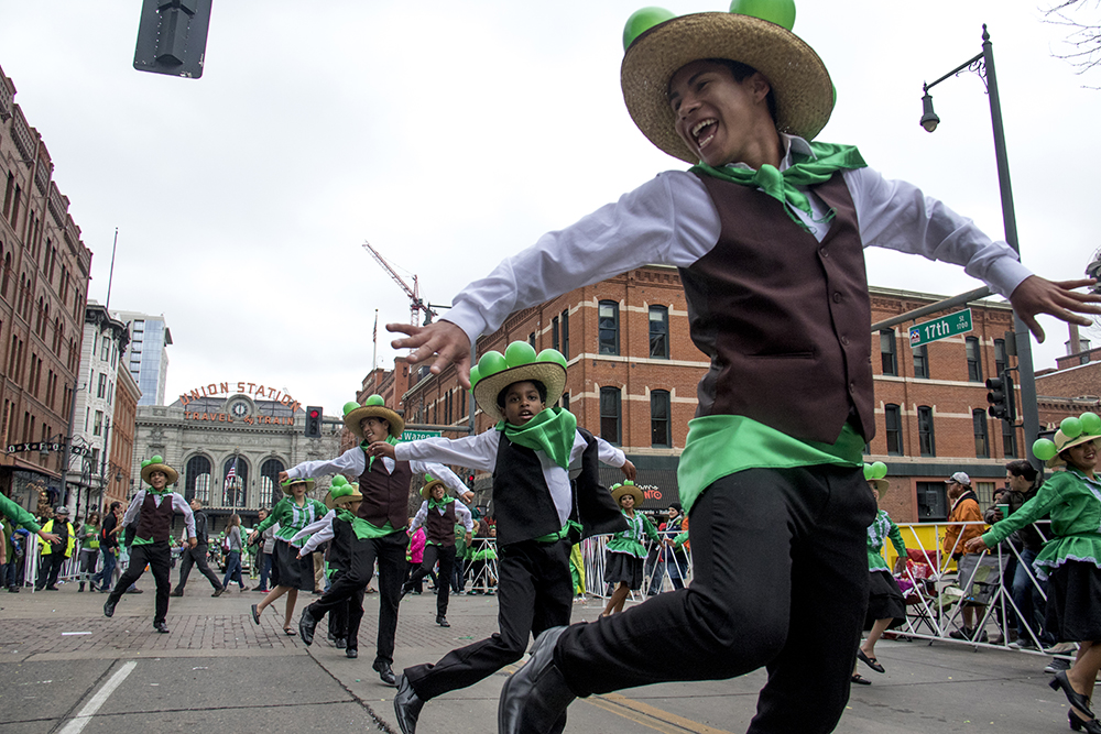 Qhaswa Peru performers skip in the parade. St. Patrick's Day celebration, March 11, 2017. (Kevin J. Beaty/Denverite)