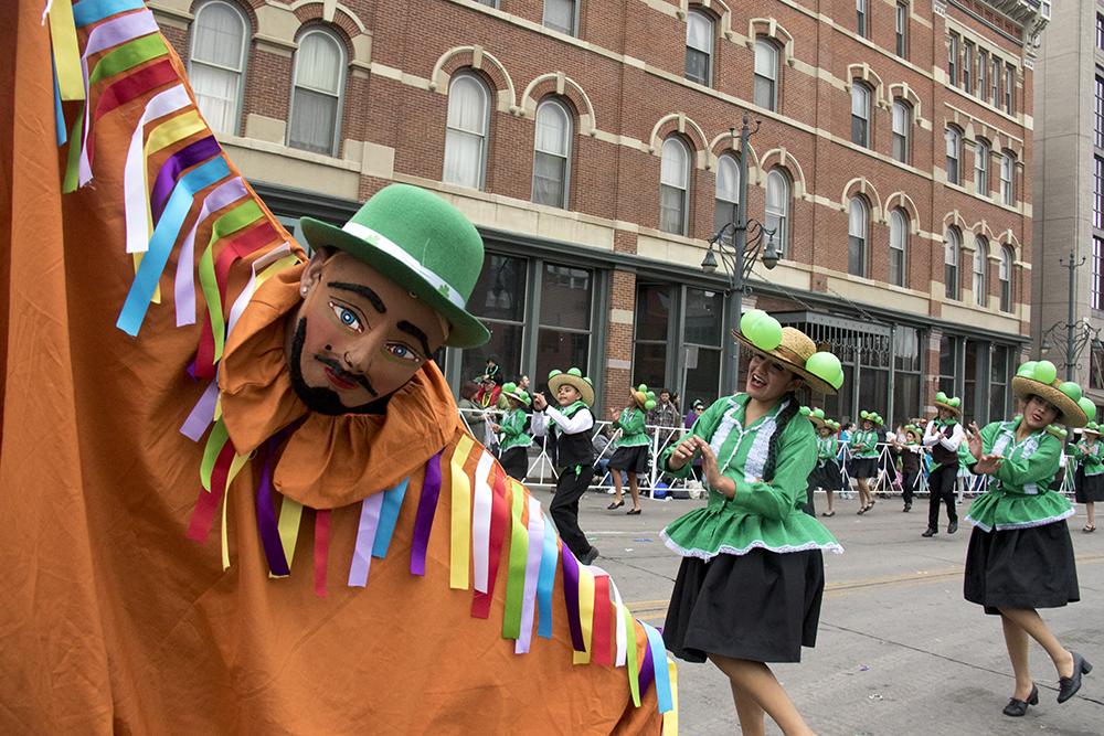 Qhaswa Peru performers skip in the parade. St. Patrick's Day celebration, March 11, 2017. (Kevin J. Beaty/Denverite)st. patricks day; union station; kevinjbeaty; denver; colorado; denverite;