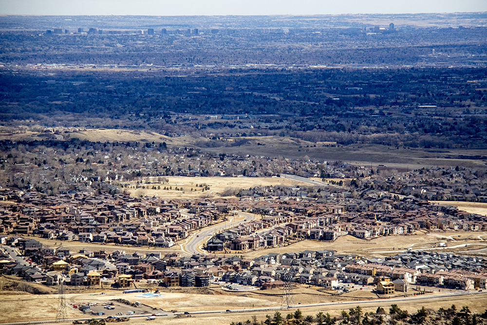 Houses on a Denver area hillside. (Kevin J. Beaty/Denverite)