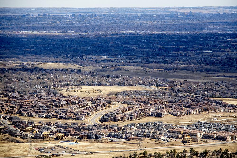 Houses on a Denver area hillside. (Kevin J. Beaty/Denverite)