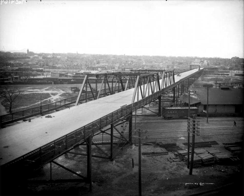 The 20th Street viaduct. (Robert Louis McClure/Denver Public Library/Western History Collection/MCC-4169)  denver public library; lodo; downtown; archival; history; viaduct; transportation; denver; colorado;