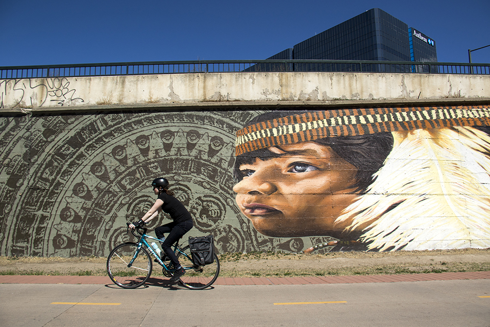 A ceremony to re-inroduce Alexandre Orion's mural on the Cherry Creek  Trail after it was vandalized this winter, March 23, 2017. (Kevin J. Beaty/Denverite)  public art; cherry creek trail; Alexandre Orion; kevinjbeaty; denverite; denver; colorado;