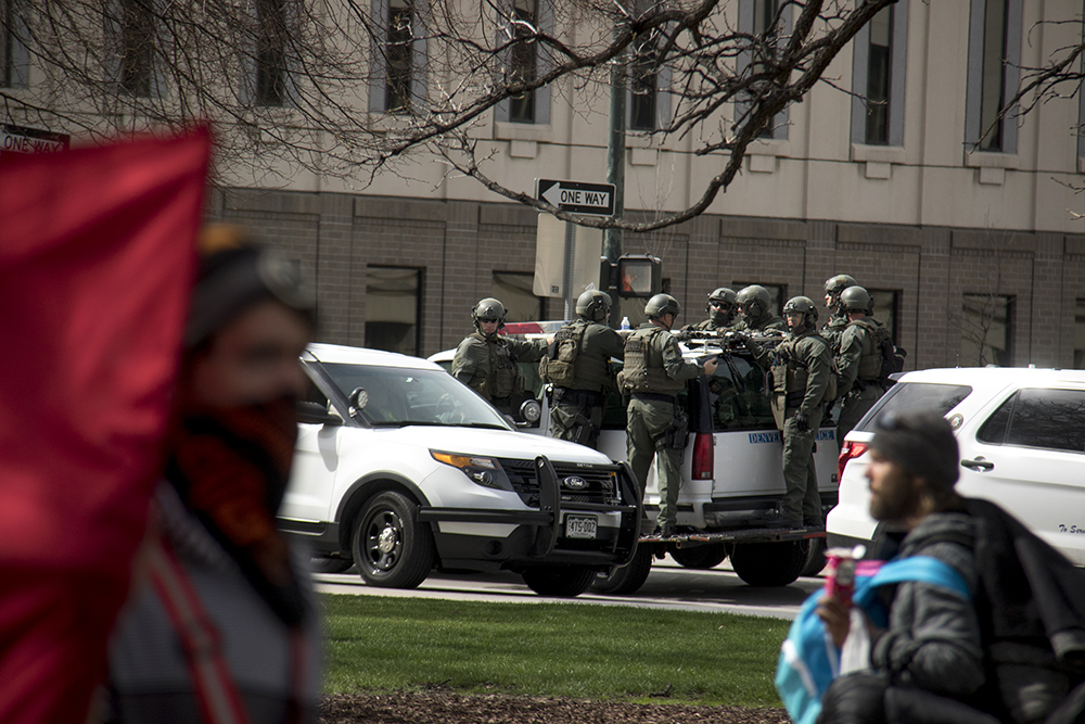 """Riot police stand by, ready for action. A """"Make America Great Again"""" rally at Civic Center Park, March 25, 2017. (Kevin J. Beaty/Denverite)  protest; rally; kevinjbeaty; denverite; denver; colorado; civic center park; copolitics;"""