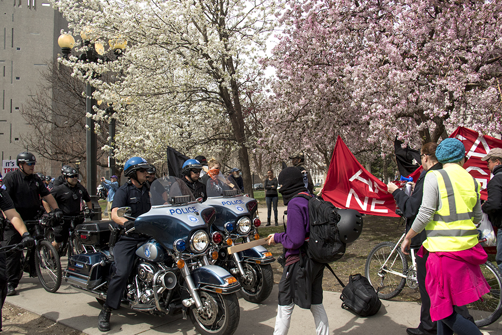 """Counterprotesters outside of a police line surrounding a pro-Trump march. A """"Make America Great Again"""" rally at Civic Center Park, March 25, 2017. (Kevin J. Beaty/Denverite)  protest; rally; kevinjbeaty; denverite; denver; colorado; civic center park; copolitics;"""