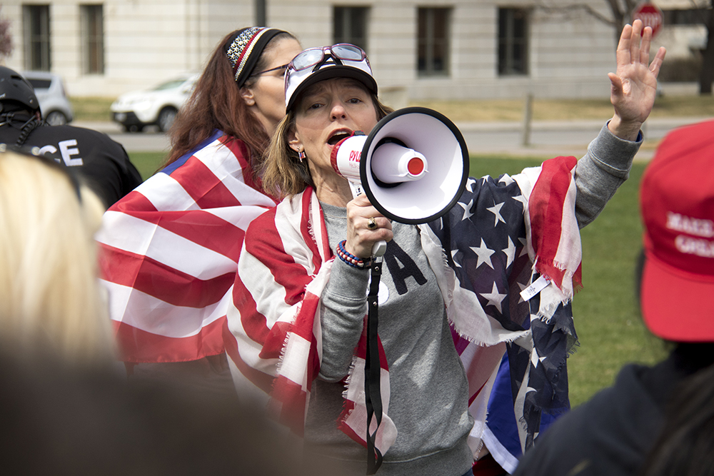 """Natasha Moore speaks at a """"Make America Great Again"""" rally at Civic Center Park, March 25, 2017. (Kevin J. Beaty/Denverite)  protest; rally; kevinjbeaty; denverite; denver; colorado; civic center park; copolitics;"""
