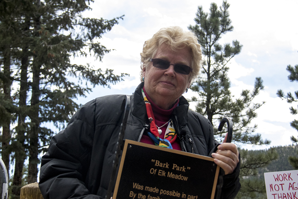 Elk Meadow Dog Park founder Judi Quackenboss holds a memorial plaque for her son that she's removed from the space before it closes. March 30, 2017. (Kevin J. Beaty/Denverite)elk meadow dog park; evergreen; colorado; kevinjbeaty; parks; denverite;