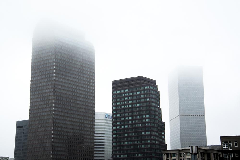 A foggy spring afternoon. (Kevin J. Beaty/Denverite)  denver; colorado; kevinjbeaty; denverite; cowx; weather; fog; dreary; rain; skyline; cityscape;