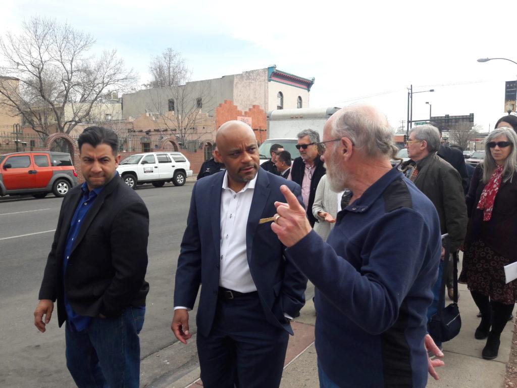 Councilman Paul Lopez and Mayor Michael Hancock listen to Santa Fe Drive community members talk about needed improvements. (Adrian D. Garcia/Denverite)