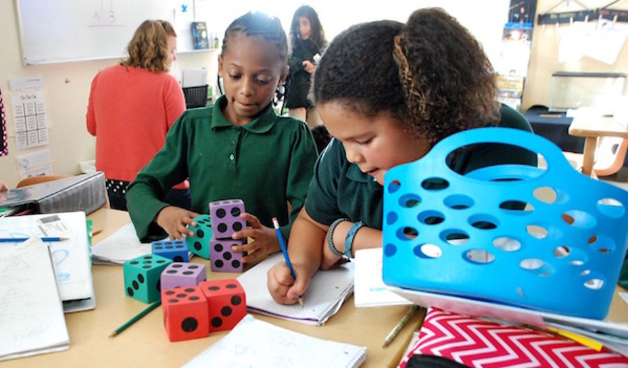 Students at the AXL Academy charter school in Aurora work on math problems in 2015. (Nicholas Garcia/Chalkbeat)