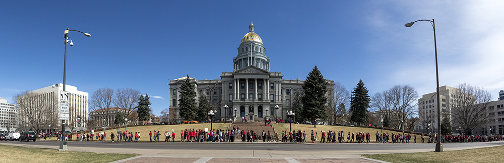 "The march completely encircled the Capitol. A rally at the Capitol on the ""day without women,"" Mar. 8, 2017. (Kevin J. Beaty/Denverite)  womens march; day without women; protest; capitol; rally; kevinjbeaty; denver; denverite; colorado; capitol building; gold dome;"