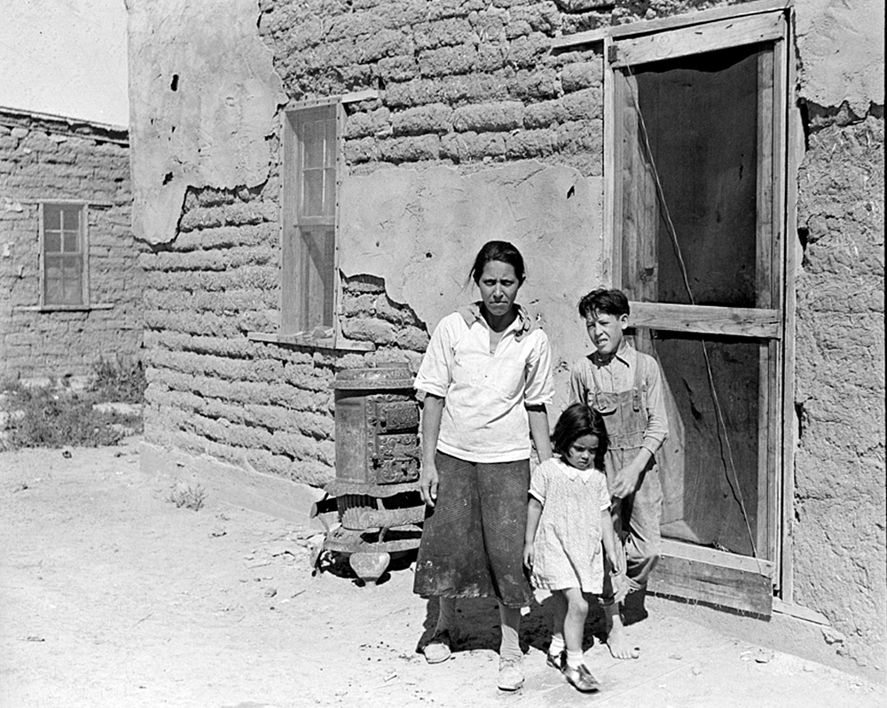 """The mother said """"I keep her dressed nice every day, because she is the only girl I've got."""" Great Western Sugar Company's beet sugar workers' colony at Hudson, Colorado, September 1938. (Jack Allison/Library of Congress/LC-USF34-015786)"""