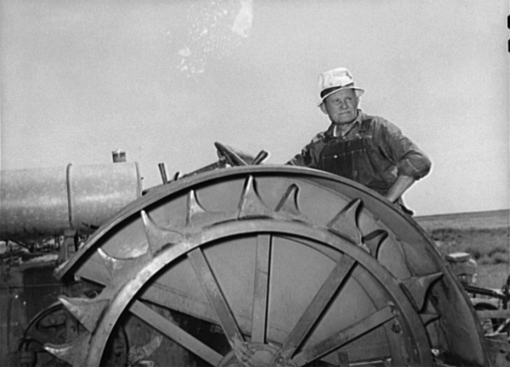 Mr. Bosley, sitting on his tractor. Bosley reorganization unit, Baca County, Colorado, Sept 1939. (Russell Lee/Library of Congress/LC-USF34-034156)