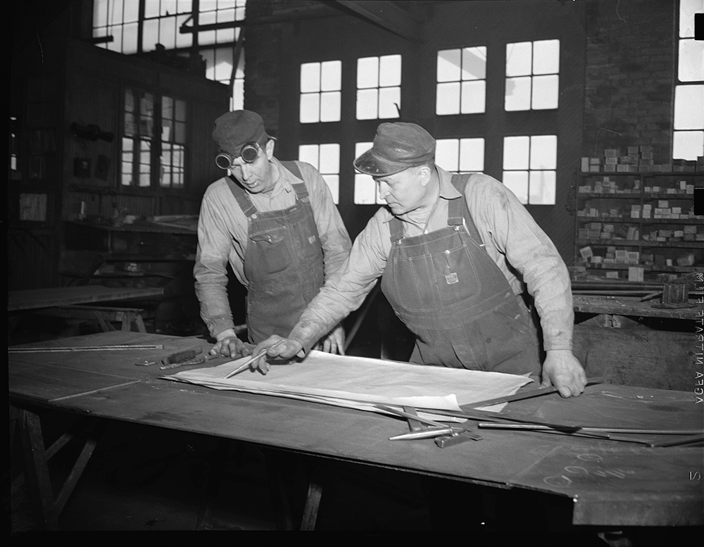 """Denver, Colorado. Two ingenious American steel fabricators who """"took a quick look at a blue print and in less time than it takes to tell it"""" turned from making steel guard rails for a gold mine shaft to building parts for Navy escort vessels, May 1942. (Library of Congress/LC-USE6-D-010591)"""