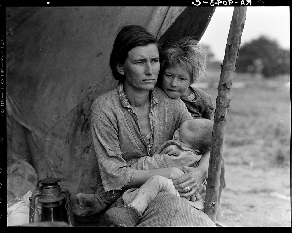 Migrant agricultural worker's family. Seven hungry children. Mother aged thirty-two. Of the twenty-five hundred people in this camp most of them were destitute, March 1936. (Dorthea Lange/Library of Congress/LC-USF34-T01-009093)