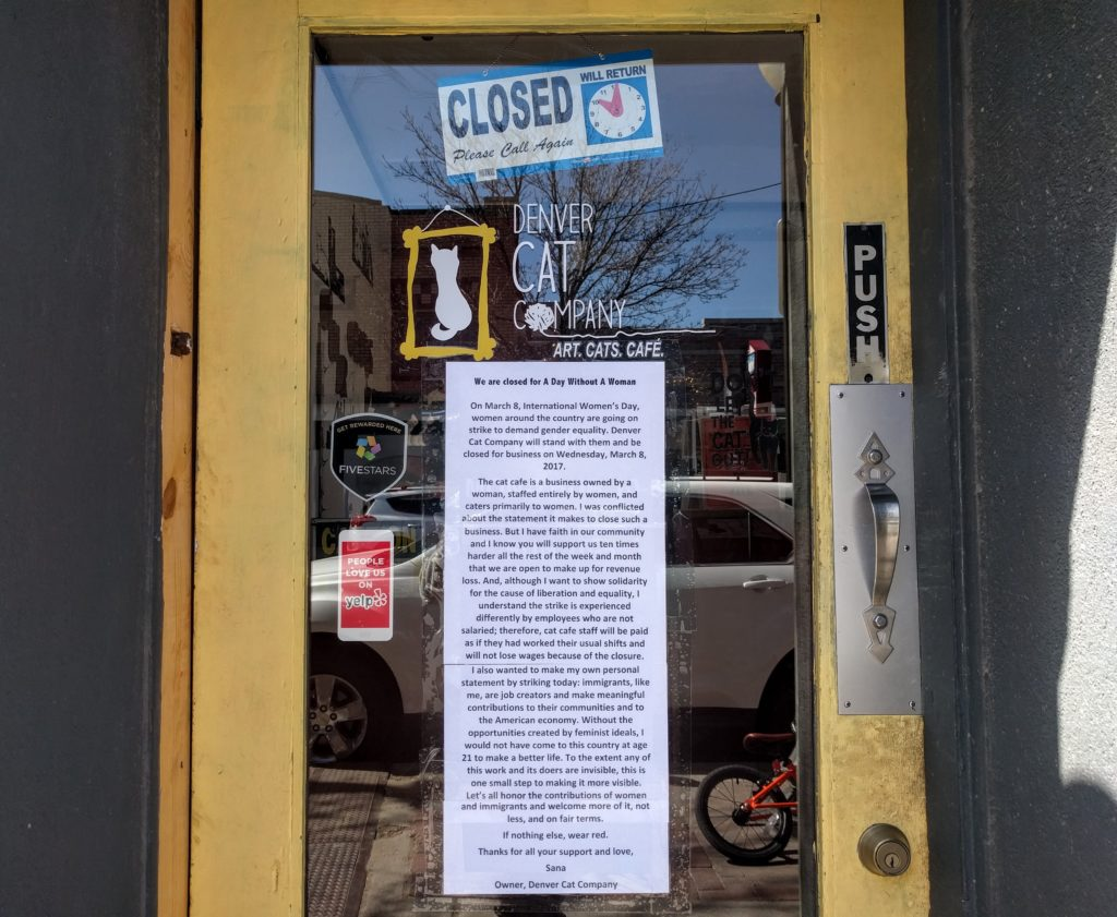 """A note on the Denver Cat Company's door explaining why it is closed on the """"day without a woman."""" (Kevin J. Beaty/Denverite)  tennyson; berkeley; kevinjbeaty; denver; denverite; retail; commercial;"""