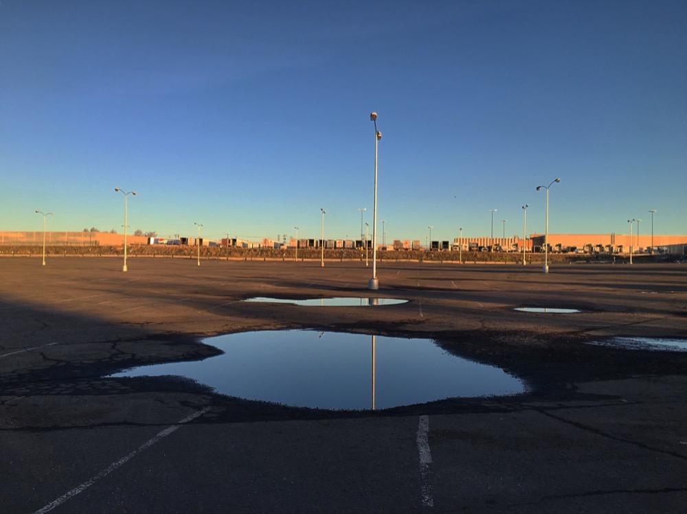 The parking lot of the Denver Coliseum near Globeville Landing. (Andrew Kenney/Denverite)