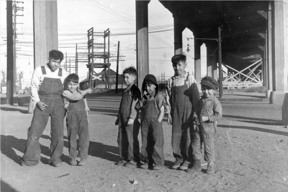 """Denver underprivileged- under viaduct - 1933 photo by E.W. Milligan,"" read the handwritten caption on this photo. (Edward Milligan/Western History and Genealogy Department/Denver Public Library)"