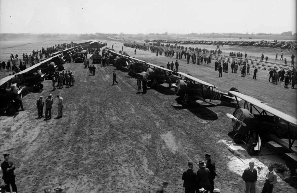 People gather at the Denver Municipal Airport (Stapleton Airport) to view fighters and transport planes of the 95th Pursuit Squadron of the U.S. Army in March 1931. (Harry Mellon Rhoads/Western History and Genealogy Dept./Denver Public Library/Engle #40484 DPLW)