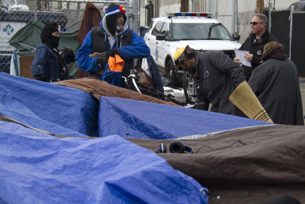 """""""Sweeps"""" of homeless camps on Park Avenue near the Denver Rescue Mission in 2015. (Kevin J. Beaty)"""