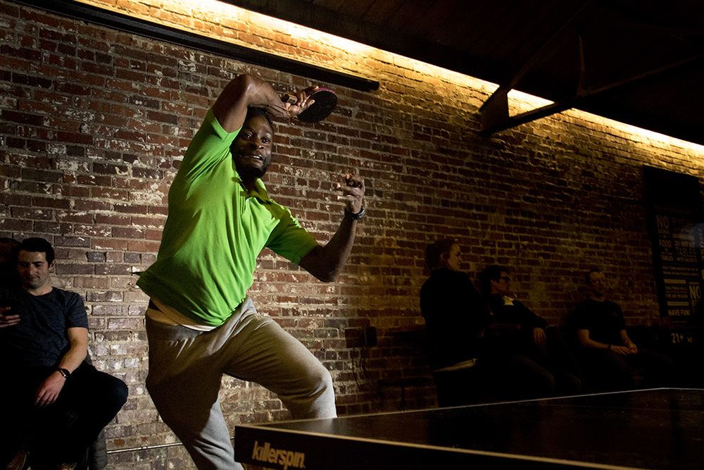 O.B. Fon plays in Ace Eat Serve's weekly table tennis tournament, March 28, 2017. (Kevin J. Beaty/Denverite)  ob fon; kevinjbeaty; denver; colorado; denverite; ace; ping pong; table tennis;