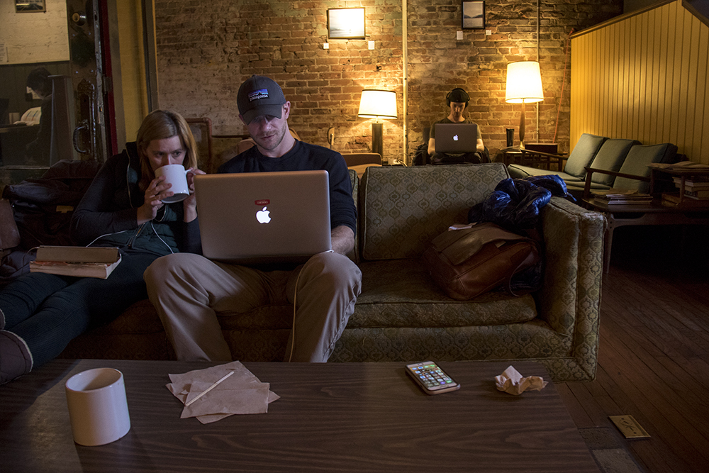 Jennifer Reuting and Chris Baldwin work on a couch inside The Bardo Coffee House, Broadway. (Kevin J. Beaty/Denverite)  coffee shops; south broadway; food; denver; colorado; kevinjbeaty; denverite; speer;