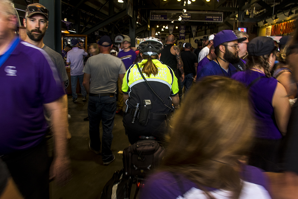 Shae Taylor rides through the crowded halls of Coors Field on opening day, April 8, 2017. (Kevin J. Beaty/Denverite)  emt; denver health; rockies; coors field; denver; denverite; colorado; kevinjbeaty