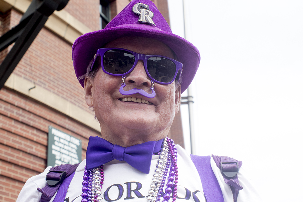 Stuart Crippen rocks a purple moustache and bow tie, among other things. Coors Field opening day, April 7, 2017. (Kevin J. Beaty/Denverite)  rockies; ballpark; coors field; sports; baseball; opening day; denver; colorado; denverite; kevinjbeaty;