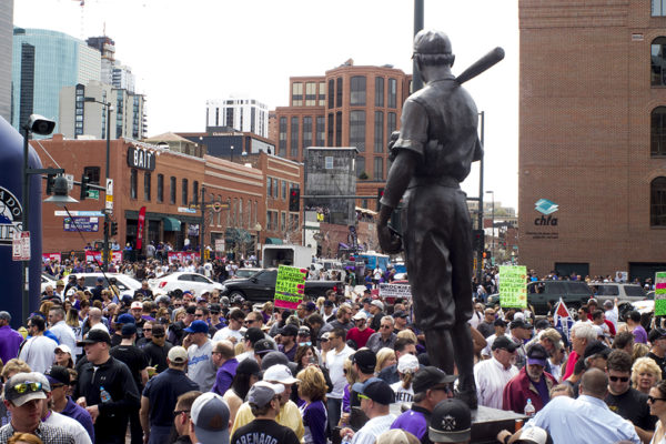 Crowds pack the intersection of 20th and Blake Streets. Coors Field opening day, April 7, 2017. (Kevin J. Beaty/Denverite)  rockies; ballpark; coors field; sports; baseball; opening day; denver; colorado; denverite; kevinjbeaty;