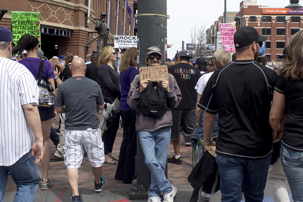A man who identified himself as Sonny Bono said he's only collected $1 in one hour. Coors Field opening day, April 7, 2017. (Kevin J. Beaty/Denverite)rockies; ballpark; coors field; sports; baseball; opening day; denver; colorado; denverite; kevinjbeaty;