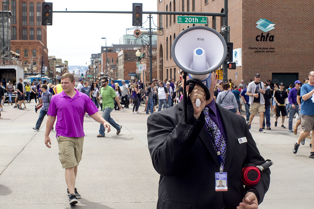 Steve Burke directs fans with a bullhorn shortly before the game begins. Coors Field opening day, April 7, 2017. (Kevin J. Beaty/Denverite)rockies; ballpark; coors field; sports; baseball; opening day; denver; colorado; denverite; kevinjbeaty;