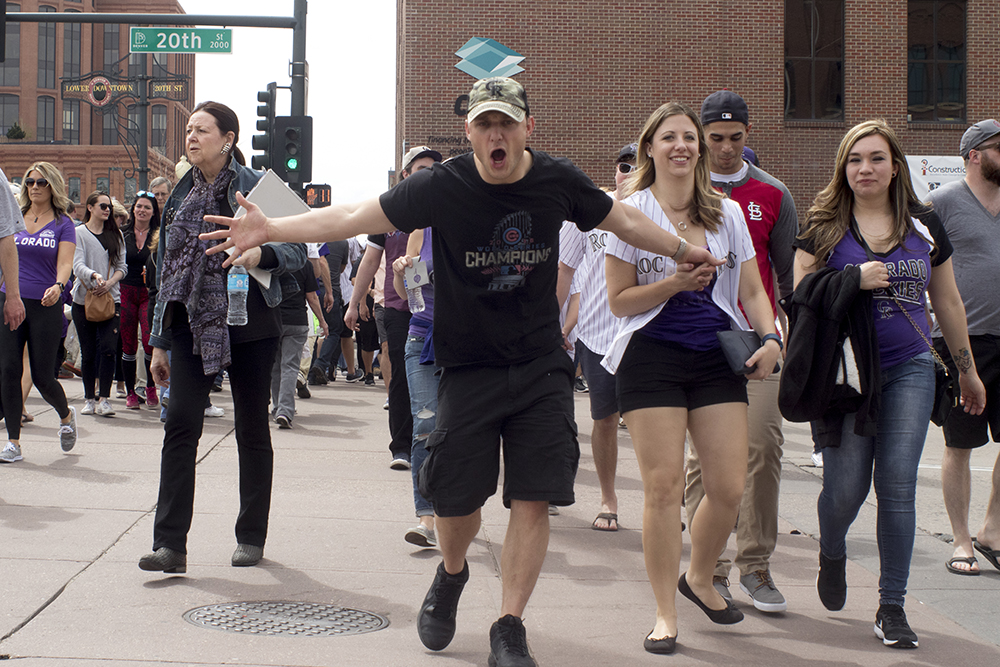 A man named Brett yells with arms wide open. Coors Field opening day, April 7, 2017. (Kevin J. Beaty/Denverite)rockies; ballpark; coors field; sports; baseball; opening day; denver; colorado; denverite; kevinjbeaty;