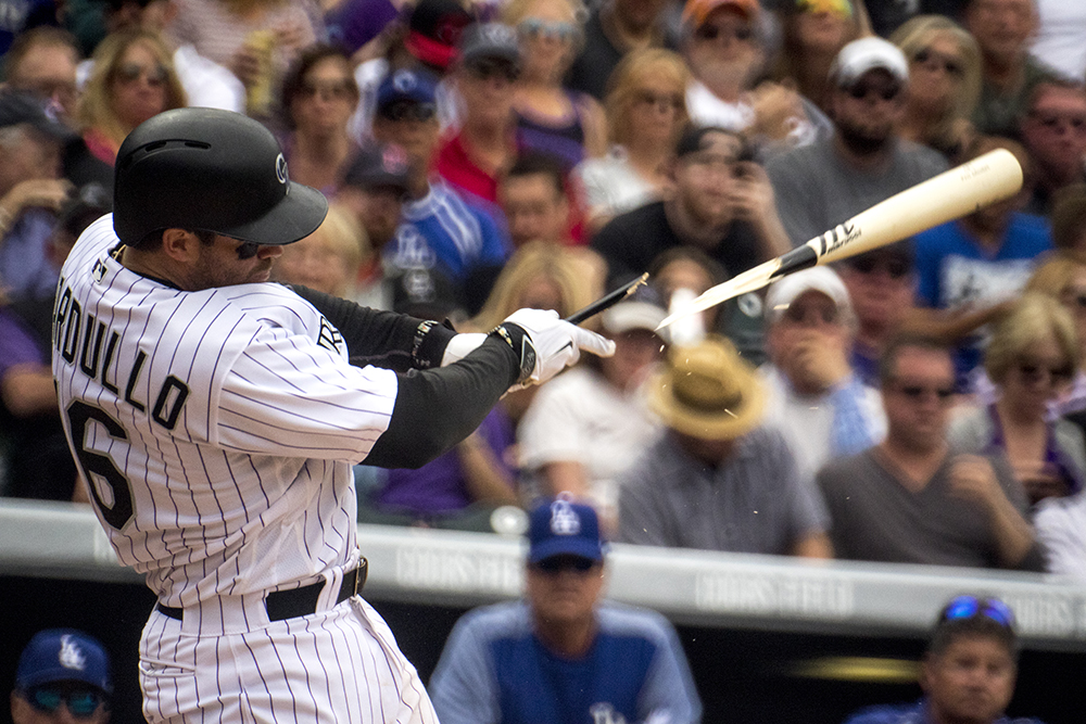 Stephen Cardullo breaks a bat. Coors Field opening day, April 7, 2017. (Kevin J. Beaty/Denverite)  rockies; ballpark; coors field; sports; baseball; opening day; denver; colorado; denverite; kevinjbeaty;