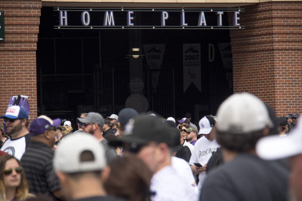 Crowds line up to enter behind home plate. Coors Field opening day, April 7, 2017. (Kevin J. Beaty/Denverite)  rockies; ballpark; coors field; sports; baseball; opening day; denver; colorado; denverite; kevinjbeaty;