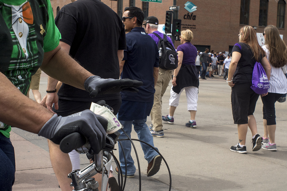 A pedicab driver makes off with $15. Coors Field opening day, April 7, 2017. (Kevin J. Beaty/Denverite)rockies; ballpark; coors field; sports; baseball; opening day; denver; colorado; denverite; kevinjbeaty;
