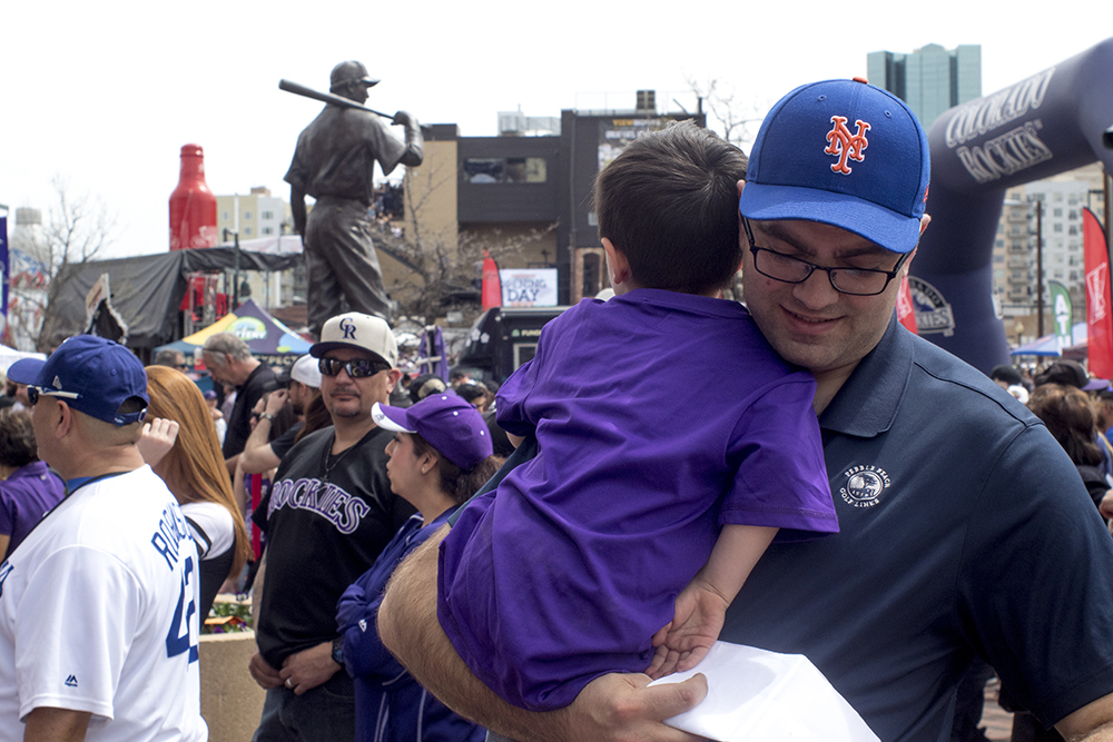Nate and Ollie Martinez wait in line. Coors Field opening day, April 7, 2017. (Kevin J. Beaty/Denverite)  rockies; ballpark; coors field; sports; baseball; opening day; denver; colorado; denverite; kevinjbeaty;