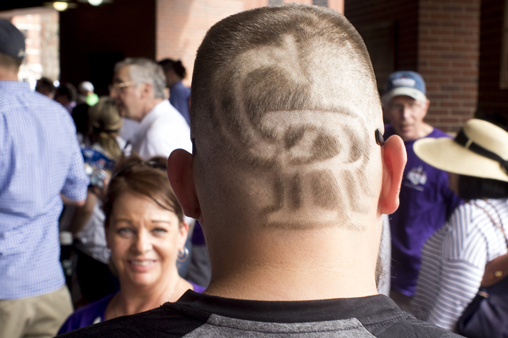 Chris Camacho has shaved the Rockies logo into the back of his head. Coors Field opening day, April 7, 2017. (Kevin J. Beaty/Denverite)  rockies; ballpark; coors field; sports; baseball; opening day; denver; colorado; denverite; kevinjbeaty;