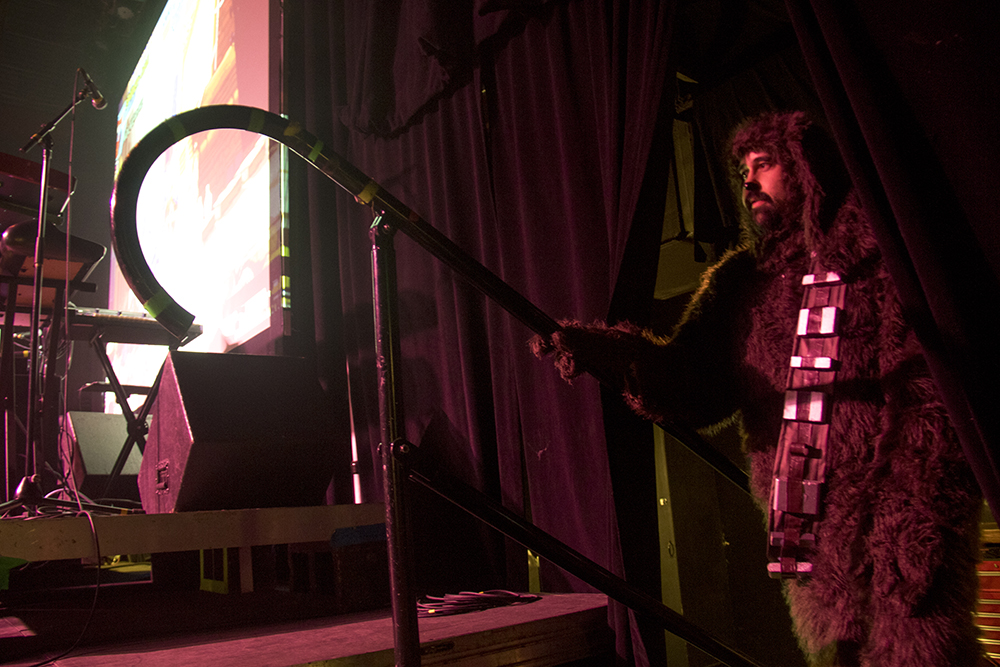 Charlie Hanson dressed as Wilfred/Chewbaca waits to walk on stage for a dance contest. Nerd Prom at Summit Music Hall, April 8, 2017. (Kevin J. Beaty/Denverite)  nerd prom; cosplay; geek; party; video games; kevinjbeaty; denver; denverite; colorado;
