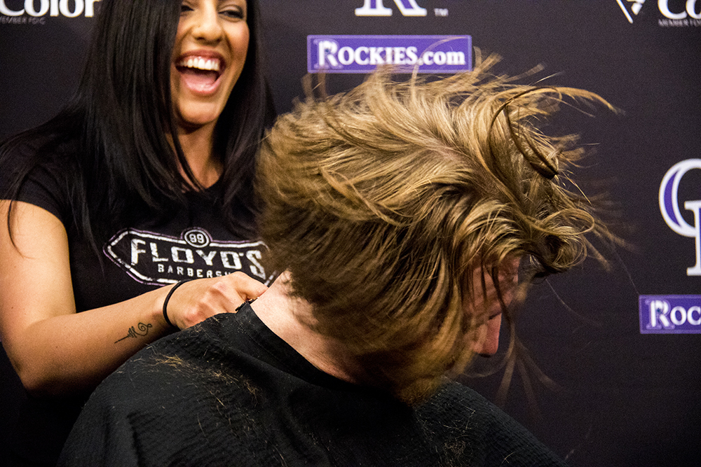 The Colorado Rockies' Jon Gray lops off 8 inches of hair for Locks of Love, April 11, 2017. (Kevin J. Beaty/Denverite)  colorado rockies; baseball; jon gray; locks of love; barber; denverite; denver; kevinjbeaty