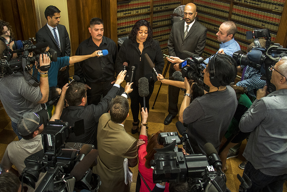 Jessica Hernandez's mother, Laura Sonia Rosales, speaks to a large crowd of press. A press conference detailing a settlement agreement between Denver and the family of Jessica Hernandez, April 12, 2017. (Kevin J. Beaty/Denverite)  jessica hernandez; denver police; chief robert white; city and county building; kevinjbeaty; denver; denverite; kevinjbeaty;