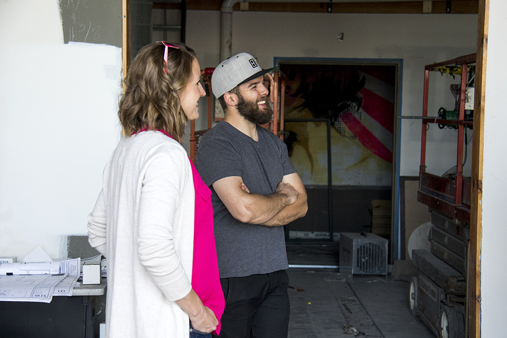 Kraig Weaver and Michelle Flake inside the future site of their Block Distilling Company, April 18, 2017. (Kevin J. Beaty/Denverite)  five points; rino; block distilling company; food; development; nightlife; denver; colorado; kevinjbeaty; denverite