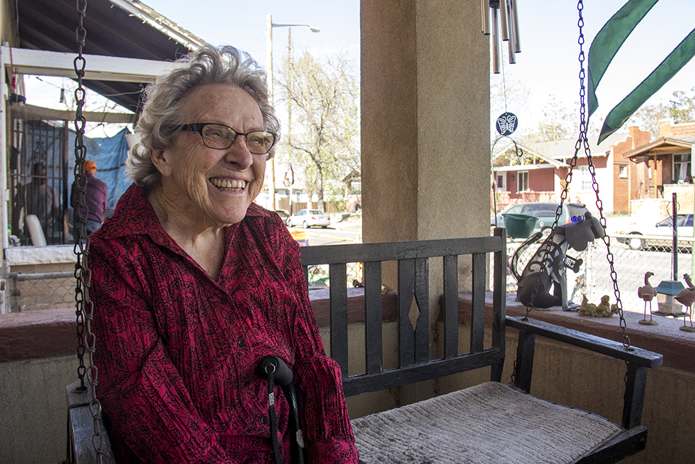 Bettie Cram on her front porch on busy Josephine Street in Elyria Swansea, April 18, 2017. (Kevin J. Beaty/Denverite)  denver; colorado; kevinjbeaty; denverite;