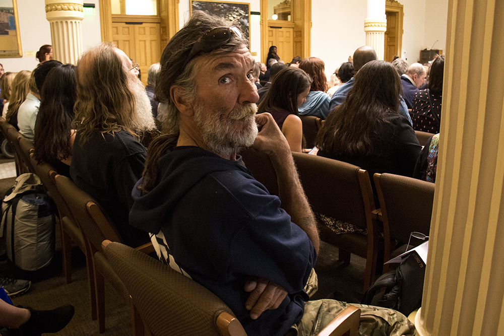 Ray Lyall listens as a bill goes to committee that would ban Denver's urban camping ban at the state level, April 19, 2017. (Kevin J. Beaty/Denverite)right to rest; homeless; camping ban; denver; denverite; kevinjbeaty; colorado;