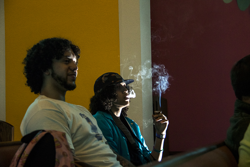 Felipe Crespo (left) and Cory Welkerle split a joint inside the International Church of Cannabis on S. Logan Street, April 4, 2017. (Kevin J. Beaty/Denverite)