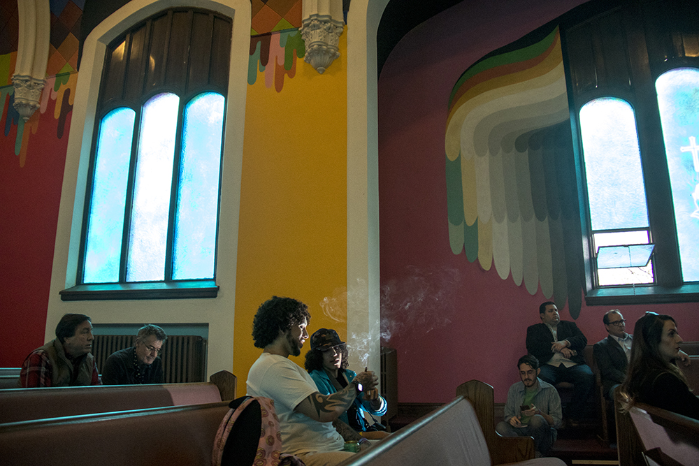 Felipe Crespo (left) and Cory Welkerle split a joint inside the International Church of Cannabis on S. Logan Street, April 4, 2017. (Kevin J. Beaty/Denverite)  420; marijuana; international church of cannabis; washington park west; kevinjbeaty; denver; denverite; colorado;